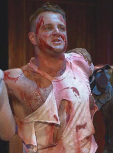 bloody man wrestling event fighting bloodied face