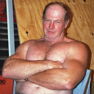 cleancut irish man sitting shirtless post wrestling event showing off hairychest furry pecs