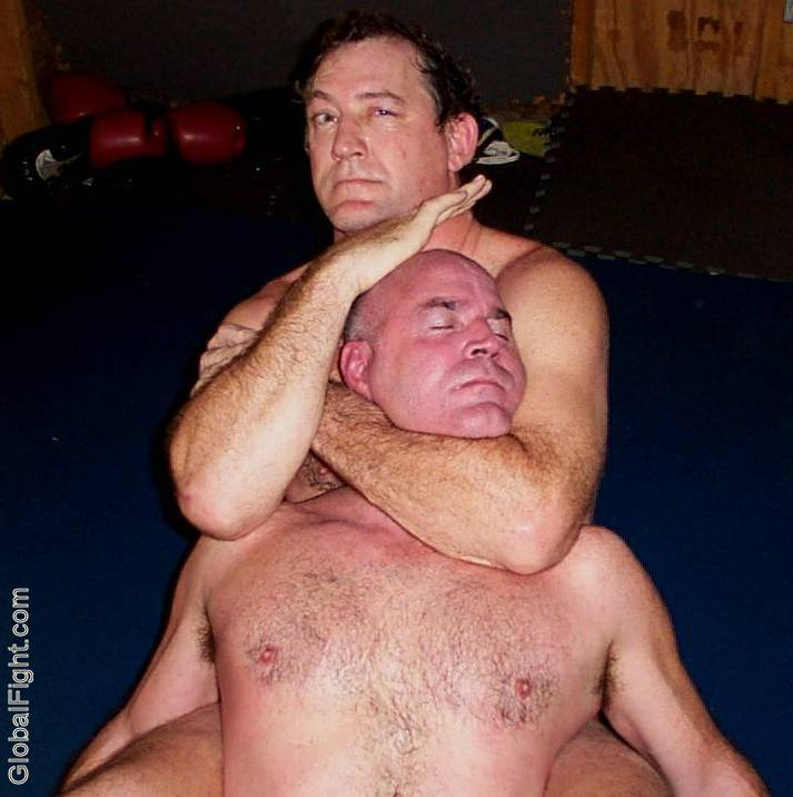 man in choked hold choked unconcious wrestling professional