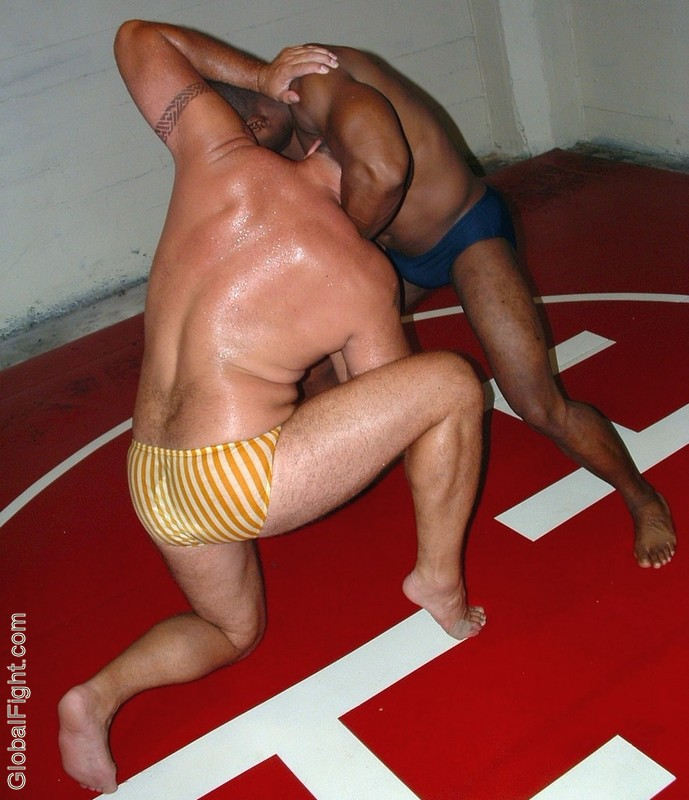 sweat dripping down mans back forced grappling matches