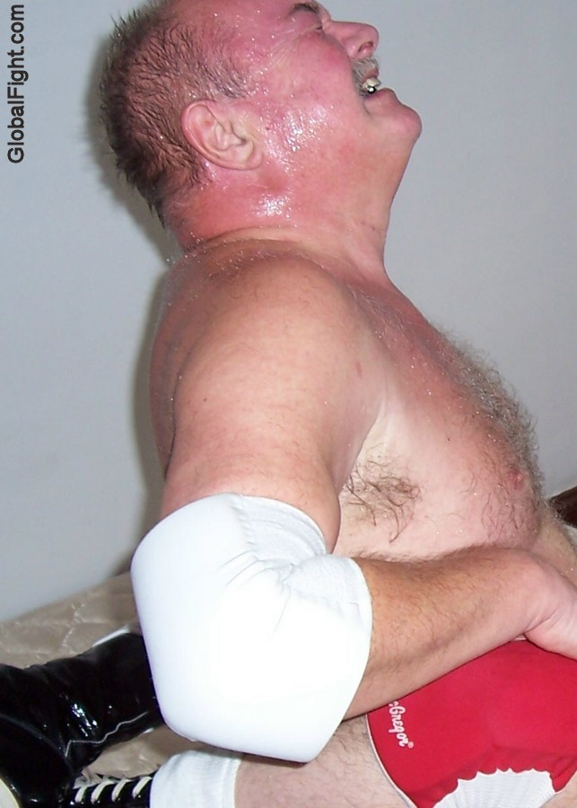 sweaty big thick neck man bear wrestling