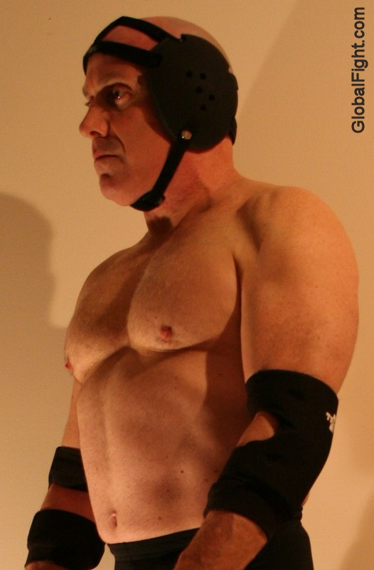 wrestler headgear muscle pecs pose down stare off