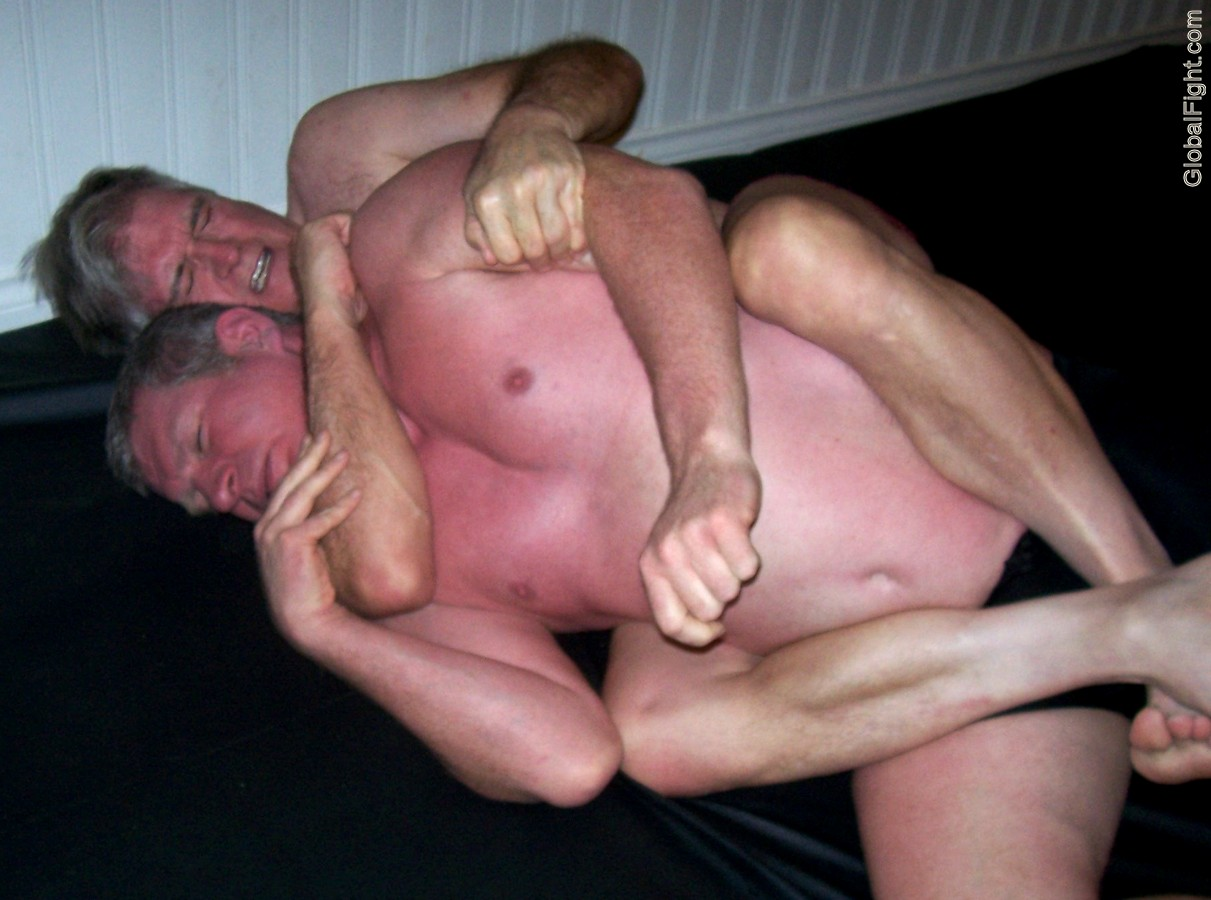 wrestling leg cradles manly tough guy squeezing guy