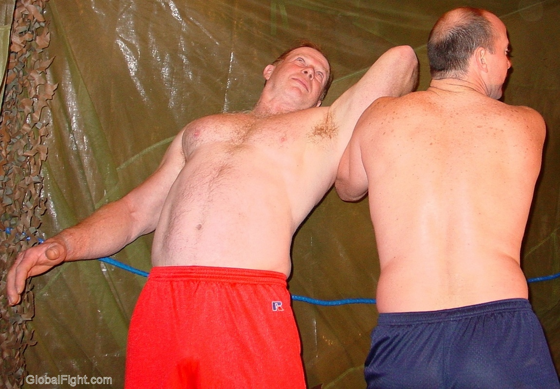 wrestling tagteam armlock guys wearing manly gym shorts